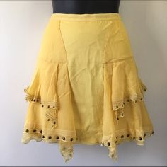 """Yellow bohemian mini skirt 4 Yellow ruffled studded silk skirt. New with tags with some fabric loose threads in front and back. Studded ruffled surface. Satin lined. Side zippered. Size 4. Measures flat layered. Waist 14"""" length 16"""". Charlotte Ronson Skirts Mini"""