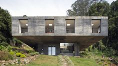 Like a grand concrete monolith being elevated out from the steep hillside, Guna House in Llacolen, Chile, is a private residence designed by Mauricio Pezo and Sofia von Ellrichshausen from architecture studio Pezo von Ellrichshausen.
