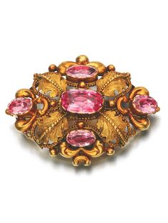 PINK TOPAZ BROOCH, 1830S Of foliate repoussé and cannetille work design, set with foil backed oval pink topaz.