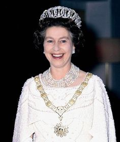 Queen Elizabeth wears the 1 million pounds pearl & diamond six-stranded necklace, a gift from the Amir when she paid a State Visit to Qatar in 1979