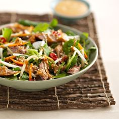 Give this crispy duck salad with a tasty ginger and soy dressing a go for your winter week-night dinner. Go to http://www.redonline.co.uk for this recipe and more.