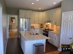 White kitchen with beige countertops.