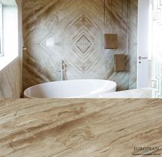 A brilliant example of the stone bookmatching technique can be seen in this bathroom feature wall. This Daino Reale marble has creamy, earthy and warm tones with a lot of interesting movement throughout the veining. Find out more here: http://www.egmcorp.com/marble/daino-reale