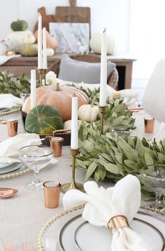 Fall Farmhouse Tablescape, pumpkins, greenery, antique gold, candlesticks, cutting boar arrangement, white linens, bronze votive holders, place setting, inviting @roomsforrent