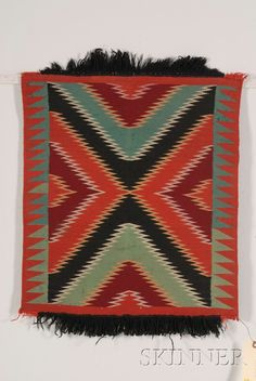 Two Southwest Germantown Samplers, Navajo, c. late 19th century, both with tightly woven multicolored geometric designs, remnant fringe on both samplers, size to 25 x 23 in. excluding fringe.