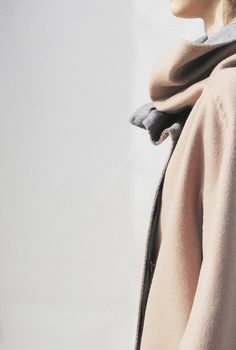 Style - Minimal + Classic: pale pink melon and light grey, cape coat with bunched funnel neck