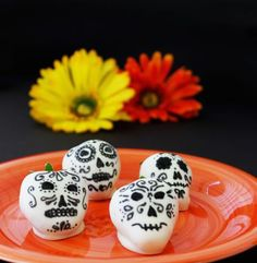 If you're looking for a less labor-intensive (but still totally festive and charming) way to make decorated skulls for your Day of the Dead bash, try these easy dipped strawberries decorated with edible black marker.  Get the recipe from Growing Up Bilingual.