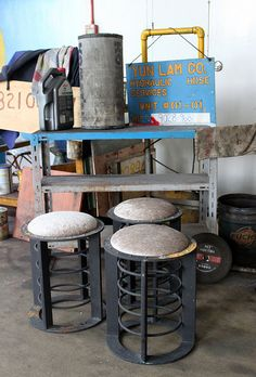 Industrial Stools  GONE BUT NOT FORGOTTEN--These three stools (foreground) are the real deal. They were originally ship's lanterns on a huge boat; we had the stool tops made and upholstered with a steel grey chenille. We have some beautiful newly made vintage industrial style pieces, but there's something special about re-purposing these heavy, old steel lanterns as comfortable seating