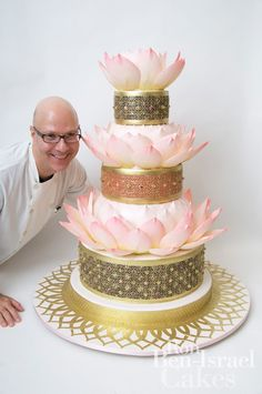 lotus wedding cake....looks awesome, the only thing ruining this pic is the guys face...creeper...