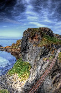 Carrick a Rede Bridge, near Ballintoy in County Antrim, Northern Ireland. The bridge links the mainland to the tiny island of Carrickarede