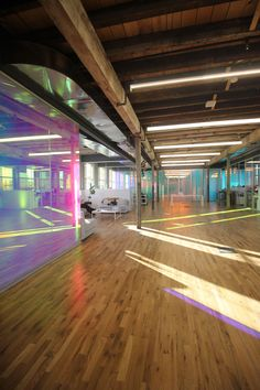 Dichroic film finishes bounce colorful light around inside adaptive reuse building.