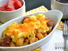 Country breakfast bowls combine seasoned and roasted potatoes, salsa, scrambled eggs, and cheddar cheese. Make them now and freeze for later! @budgetbytes