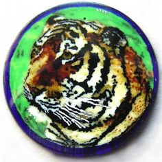 Murrini Tiger by Mario Dei Rossi. This rare Tiger murrini was created by the Murano glass master Mario Dei Rossi using the fused rod method of murrini making. The Tiger murrini measures 18mm diameter and is 3mm thick. A true collectors item and one of several different murrini offered by Frantz Art Glass at this time.