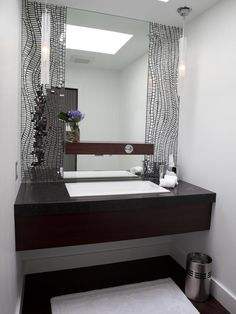 Mirrored mosaic tile frames the main mirror in this contemporary single-vanity bathroom. The beautiful dark vanity appears to float below. Bathroom Tiles Images, Bathroom Tile Designs, Bathroom Interior Design, Bathroom Ideas, Bathroom Photos, Rustic Bathroom Vanities, Chic Bathrooms, Vanity Bathroom, Bathroom Wall