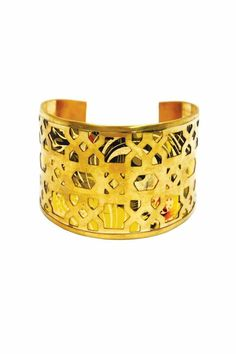 A vibrant print in yellow and orange tones is encased by architectural Moroccan inspired cut outs. Wear with the other cuffs from this collection for advanced style. One size fits most, base is adjustable.   Grenada Cuff by Made It!. Accessories - Jewelry - Bracelets New Jersey