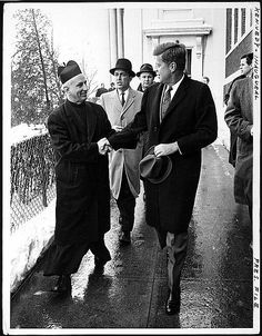 """President-elect John F. Kennedy shakes hands with Father Richard J. Casey, the Pastor, after attending Mass at Holy Trinity Church ... prior to inauguration ceremonies."" Image courtesy of Library of Congress"