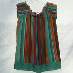 Muti-colored Sleeveless Tunic A striped, multicolored, earth-toned tunic with elastic gathering neckline. 100% Polyester Never been worn, like new! Voice Stretch  Tops Tunics