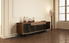 The GRAMMI sideboard is a minimal piece of furniture combining straight and orthogonally arranged lines.  Is based on four drawer bodies that compose an elegant volume, featuring a solid surface of selected marble slabs, subtly combined with soft and warm wood patterns.