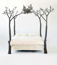 A tree bed.. hmmm paint the room blue and white and you might feel like you are in a tree house!