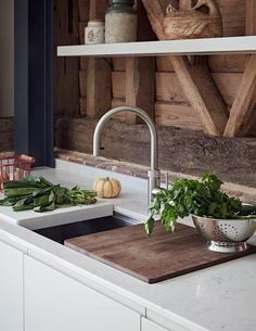We are all about colour and texture at John Lewis of Hungerford. This is a small detail shot from one of our client's kitchens, a contemporary Pure handleless kitchen set within a barn conversion. The client achieved the perfect balance between the modern fittings and the more rustic barn setting. Wooden worktops paired nicely with the oak beams in the barn structure, and the steels were painted a similar colour to the island cabinetry - a small detail but very effective