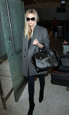 Rosie Huntington-Whiteley in a grey coat, skinny jeans, ankle boots and a Givenchy bag #style #fashion #celebritystyle