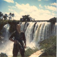 Soviet officer poses at a waterfall near Kuembo in April