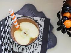 Pumpkin pie spice and apple cider lend autumnal flavor to this Halloween take on classic sangria. Serve in a hollowed-out pumpkin for a dramatic presentation.