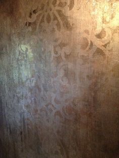 Distressed silver foils with a RDS stencil. Work by Tiffany Alexander of Blank Canvas Design Studio.