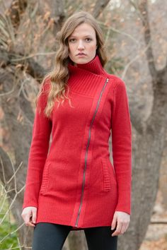 This asymmetrical full-zip sweater is made in a nylon/wool blend which gives it a soft hand and makes it easy to care for.