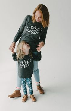Hello, hi, howdy, hey hey — we're offering up friendly greetings this season with this beautiful graphic from @paperheartcalligraphy on the signature Charcoal pullover for kids AND ladies! Check it out for PRE-SALE now at www.littleandlively.com . . . Photo by @jaymelang