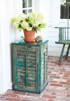 Who knew that old wooden shutters could be recycled so simply into the perfect outdoor summer table? Whatever your preferred finish may be, you can prepare your shutters by sanding, painting or staining them. Just make sure all four of your shutters are the same size. The top and bottom of the shutter table is made from art stretchers. This is a creative, easy way to make a square top. The glass easily rests on the top inside the beveled edge.