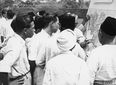 "Residents of Malacca study he map showing their ""white area"""", 1948-1960"