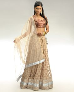 Beige Lengha with Blouse and Dupatta    Floral mesh of copper colored gota and textured silver colored gota band adorns the lame base at lengha hem    Beaded trimming adorns the hem edge    Tasseled adjustable drawstring at the waist with hook and eye closure    Matching silk blend inner attached    The set includes maroon brown brocade silk blend blouse with diamond neckline and cap sleeves    Scoop back with tasseled string accent    Hook and eye closure in the front