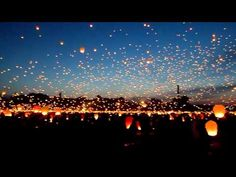Flying Wish Lanterns!  Simply Beautiful!  @Rebekka Frazier... We should do this at your wedding since they did it in Tangled!! :)
