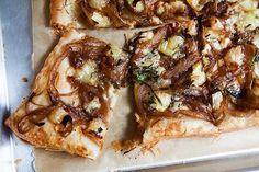 Crispy savory tart made with puff pastry, caramelized onions, and gorgonzola and brie cheeses.