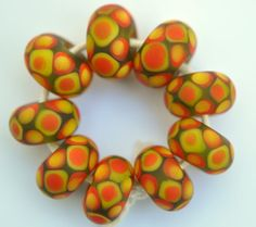 Check out this item in my Etsy shop https://www.etsy.com/listing/231057690/greenyellow-and-orange-spotty-dotty