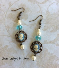 Small Cameo's are mounted onto a small bezel and then attached to a filigree stamping, pearls and glass beads also used .. For Sale $18.00 ..https://www.etsy.com/shop/CleverDesignsbyJann