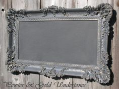 A vintage frame is painted in a pretty pewter gray, a backer board is painted with chalkboard paint and voilà! - an amazing chalkboard!