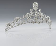Lannoy Family diamond tiara. The tiara is composed of 270 old-cut brilliants set in platinum, with a diamond in an inverted pear shape superimposed in the centre. The tiara was made by Altenloh in Brussels circa 1878. (=)