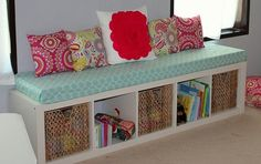ANY shelf turned on it's SIDE.... add long foam cover pad. ( or use one that fits from the patio ) add pillows and you have a lovely .... WINDOW SEAT  littlemomentslikethis.com