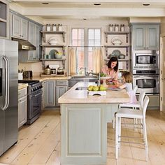 grey L-shaped kitchen with island