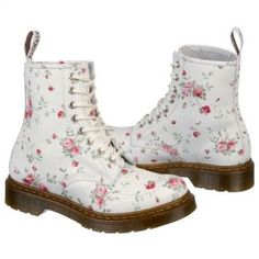 Floral Dr. Martens lace-up boots are sweet and edgy all at once. #boots #floralfashion #ankleboots