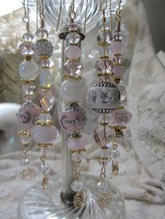 Pink Shabby Chic Victorian Christmas Ornaments by LaReineDesCharmes, via Etsy. The largest of the beads on each is made from polymer clay and inlaid with various do-dads.