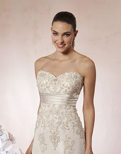 Sweetheart / Wedding Gowns / Style #5996 / Available Colours : Ivory/Silver, White/Silver - A sweetheart neckline accented by beaded lace appliqués and a satin cummerbund at the empire waist on this taffeta mermaid gown. Buttons cover the back zipper and onto the chapel length train (close up)