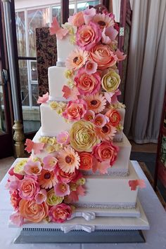 Peach and pink flower cascade. Roses, gerbera, tulips. Beautiful Wedding Cakes made to order in Swansea and South Wales. Custom made design to your specific needs. Looking elegant and tasting delicious. Please contact me with any questions or to arrange a consultation.