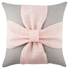 """Add a touch of charming style to your sofa, arm chair, or window seat with this handmade burlap pillow, showcasing a bow accent for charming appeal.   Product: PillowConstruction Material: Burlap cover and down fillColor: Grey and pinkFeatures:  Bow accentHandmade by TheWatsonShopZipper enclosureMade in the USA Insert included Dimensions: 16"""" x 16"""""""