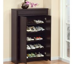 Front Door Shoe Storage: hides shoes and nice height for dropping off purse, keys, etc. I prefer a higher storage unit at the front door rather than a low bench.