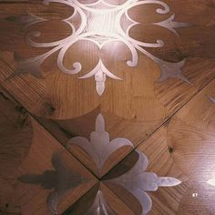 reclaimed oak with stainless steel inlay flooring - whoa.