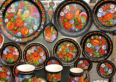 Petrykivka Ukrainian art on the plates.  Have few on the wall in the kitchen.