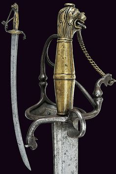 A sabre with lion head shaped pommel, dating: third quarter of the 17th Century provenance: Swiss